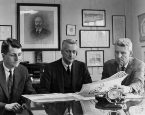 The Taylor team in 1967: Publisher William Davis Taylor, flanked by his son and successor, William O. Taylor,left, and his cousin, Globe President John I. Taylor. In photo at rear, the newspaper's first publisher, Charles H. Taylor, who was Davis's grandfather.