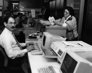A staffer at a computer in the Globe library offices
